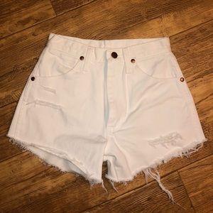 White Wrangler cut-off shorts